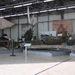 Ebbe a hangárba már csak belesni tudtam, a kapu félig zárva volt. De így is kiszúrtam a Messersccmitt Bf-109 roncsát, amit ki tudja hol találhattak