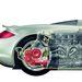 Íme a középmotor. A Carrera GT esetében a súly 60 százaléka jut a hátsó tengelyre, ami hátsókerék-hajtás esetén előnyös