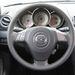 Már régi modell a Mazda 3, de azért mi még emlékezzünk: a csőműszereket az Alfából, khm, vették