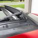 A hátratolt üvegtető alól szélvédő háló emelkedik ki, feltekeredő rolóval lehet árnyékolni, ha túl erősen tűz a nap
